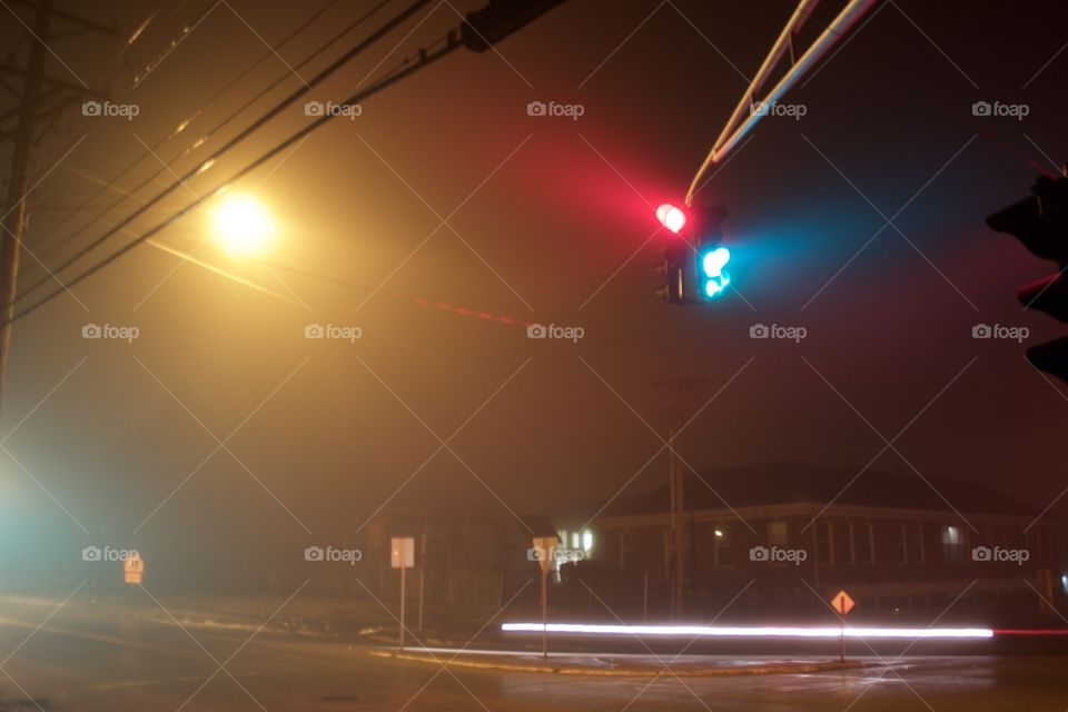 A long exposure of the traffic lights at the corner of my street.