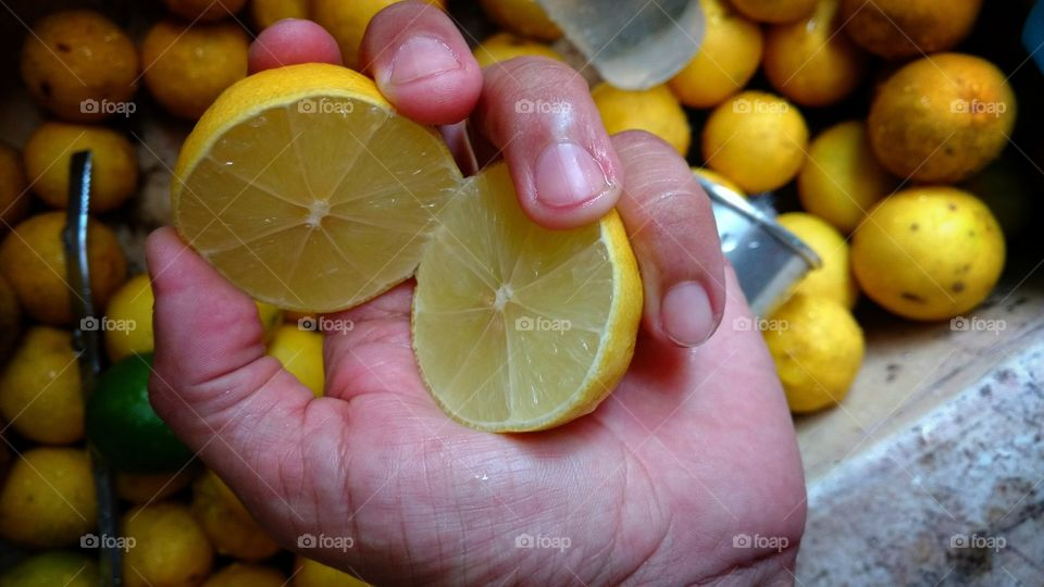Close-up of women holding lemon