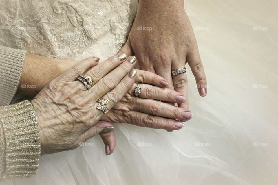 Hands of three generation together