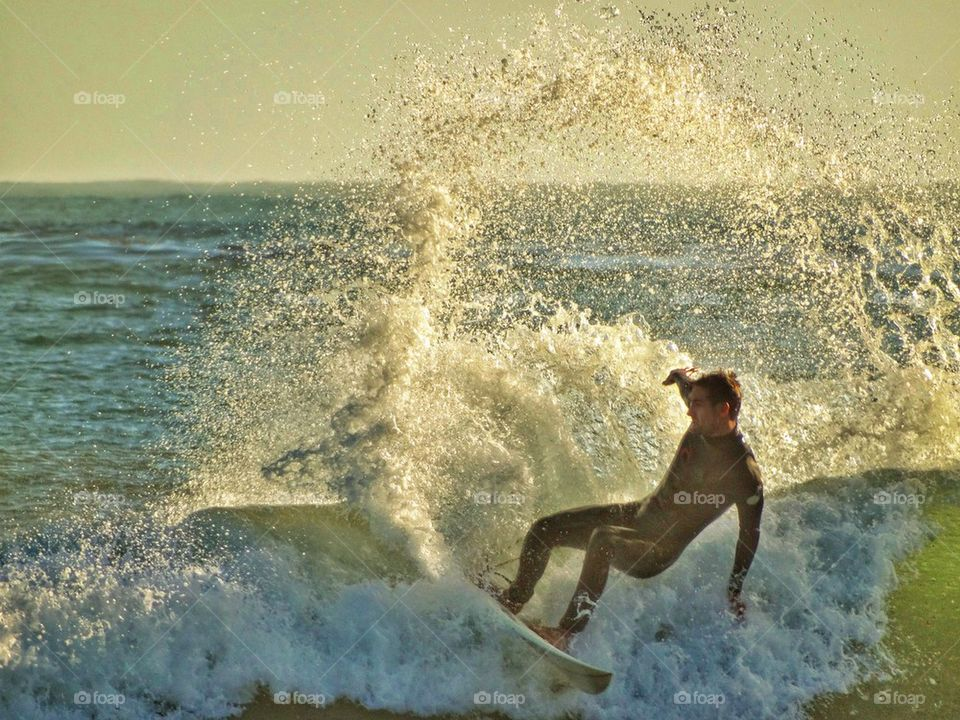 Awesome Surfer Kicking Up Epic Spray. Epic Surfing