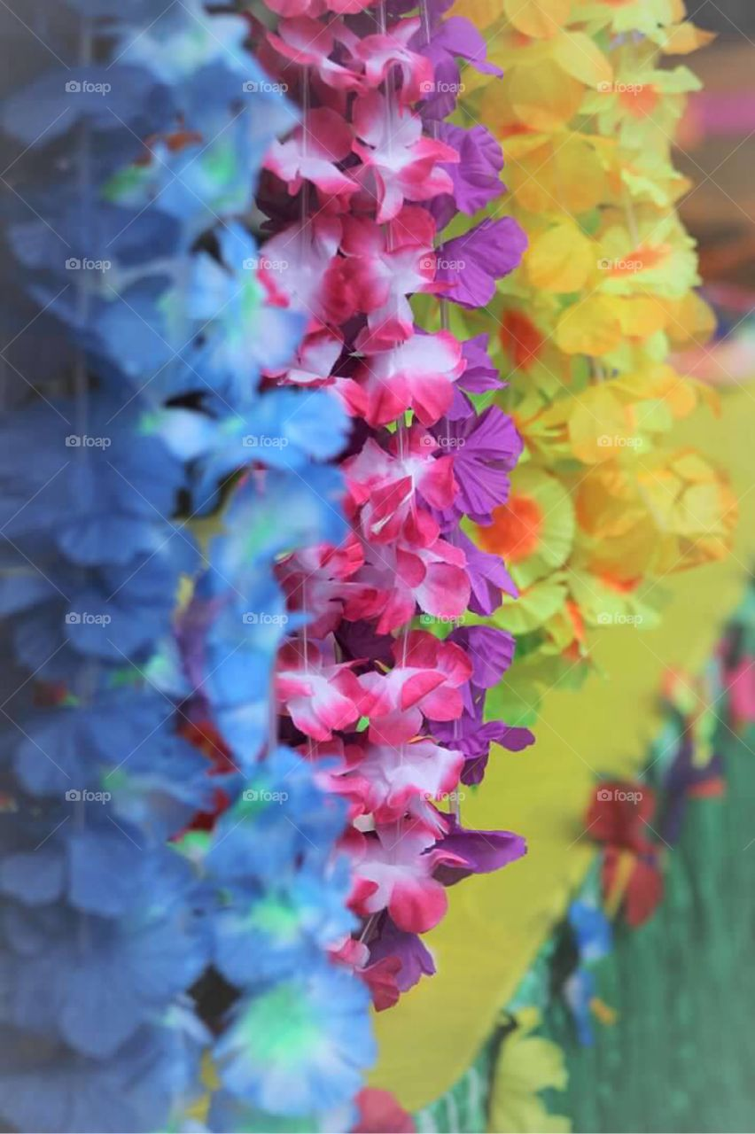 Bright and colorful Hawaiian flower leis ready for the tropical luau birthday celebration.