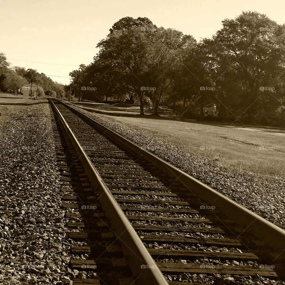 Rails. A sepia of a local train track