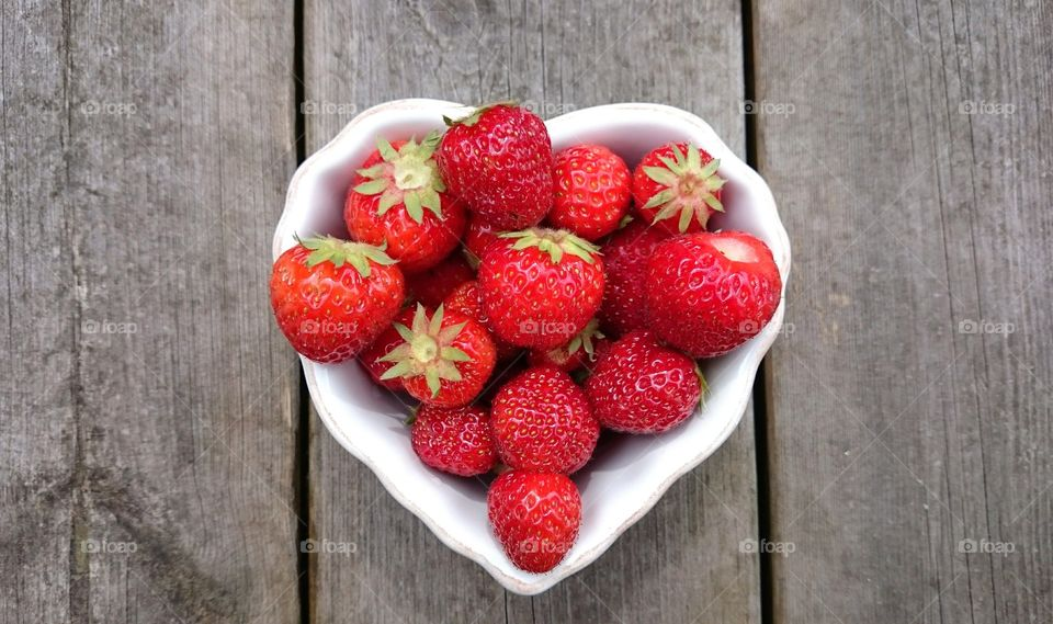strawberries in a heartshaped bowl