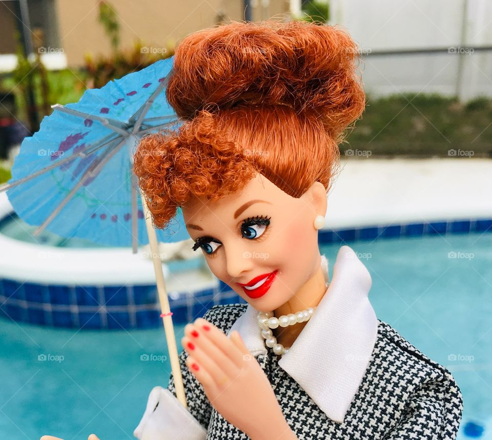 Staying dry with an umbrella and an I Love Lucy Barbie