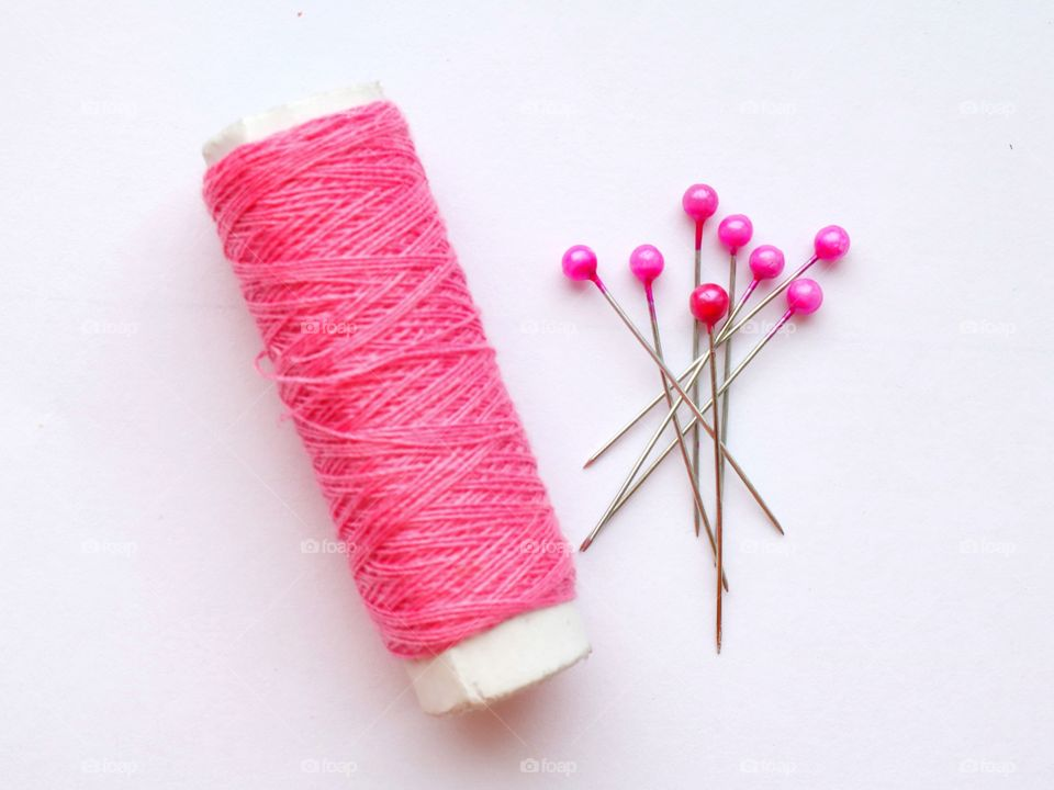 Close-up of pink spool and pin